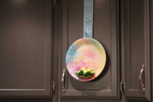 cabinet decorated with paper plate and marshmallow peeps nest