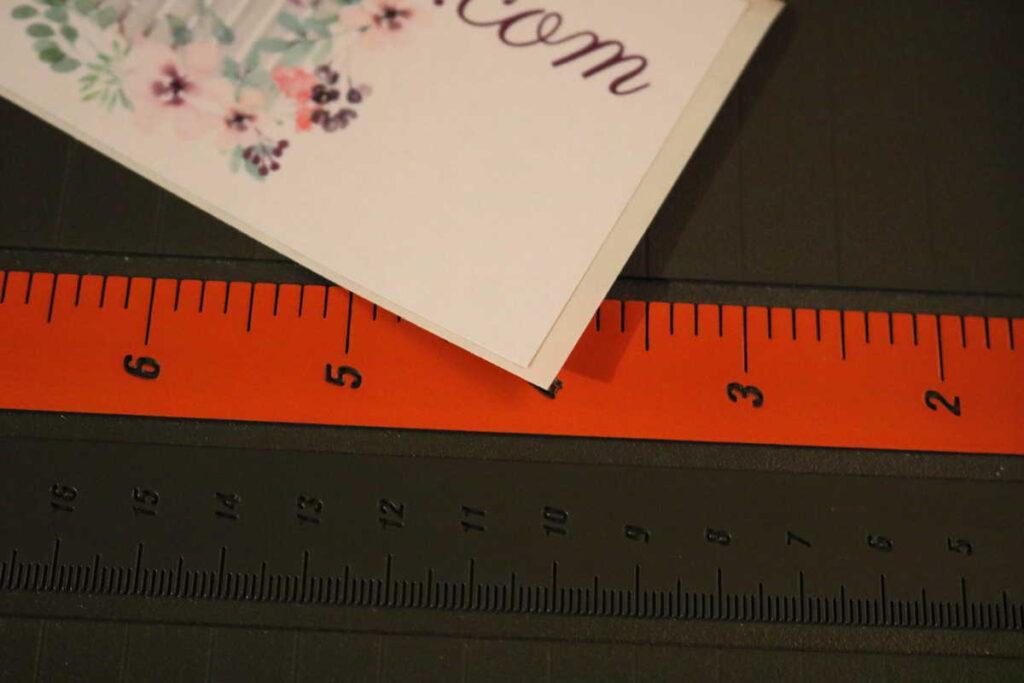 closeup of corner of sticker trimmed smaller than the original sticker backing