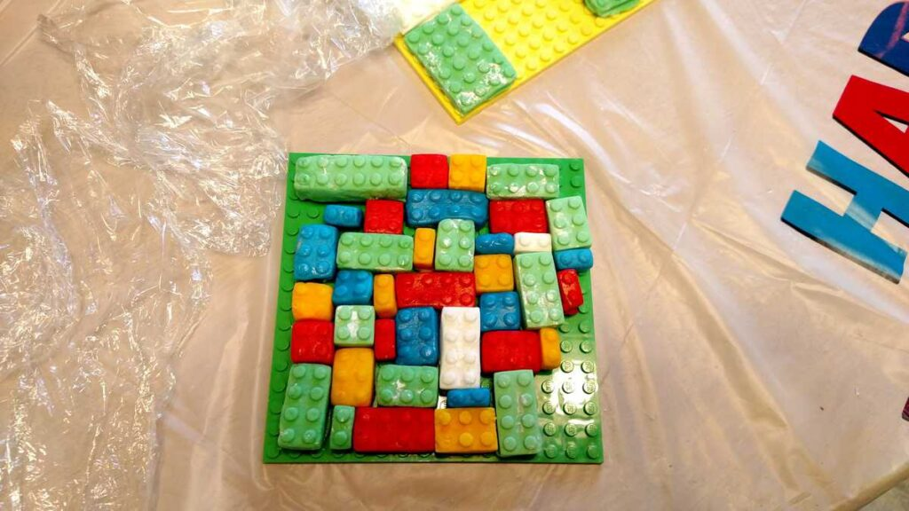 green, red, blue, yellow, and white fondant lego blocks
