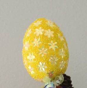 closeup of faux yellow beaded Easter egg