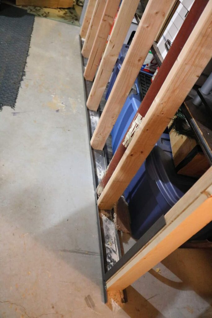 use metal to frame part of basement wall