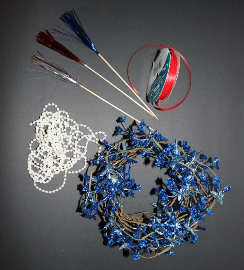 3 fireworks toppers, red ribbon, pearl string of beads, blue flowers