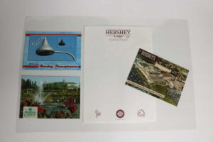 laminated placemat of postcards and stationery