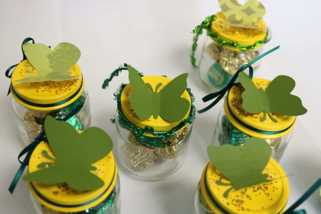 view from the tops of the jars with butterflies on them https://www.b4andafters.com/Baby-Shower-Favors