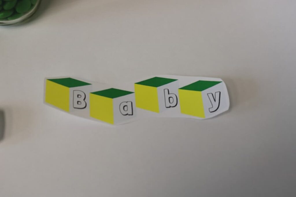 paper label with baby spelled onto blocks https://www.b4andafters.com/Baby-Shower-Favors