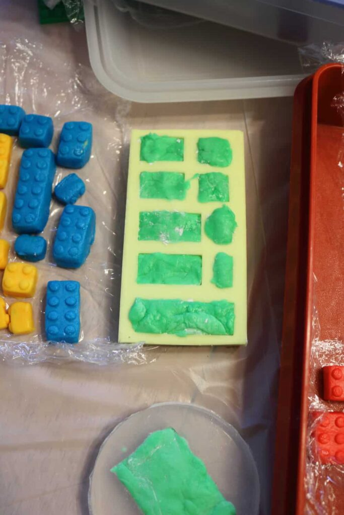 putting the marshmallow fondant in the molds