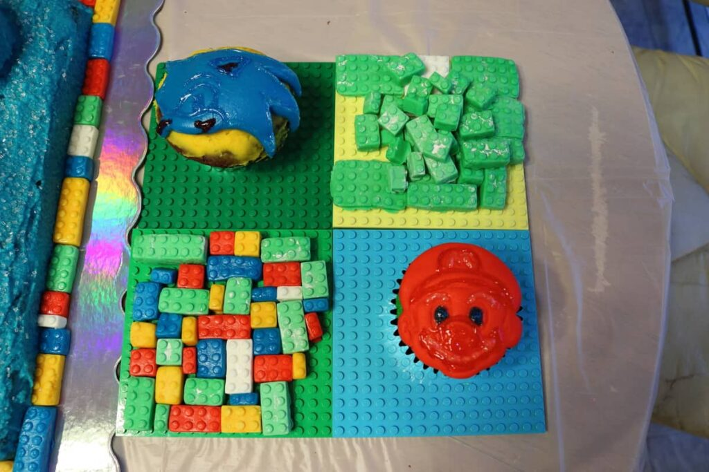 extra fondant lego pieces and sonic cupcake and super mario cupcake