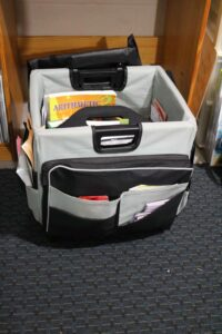 rolling storage tote with black and gray pockets