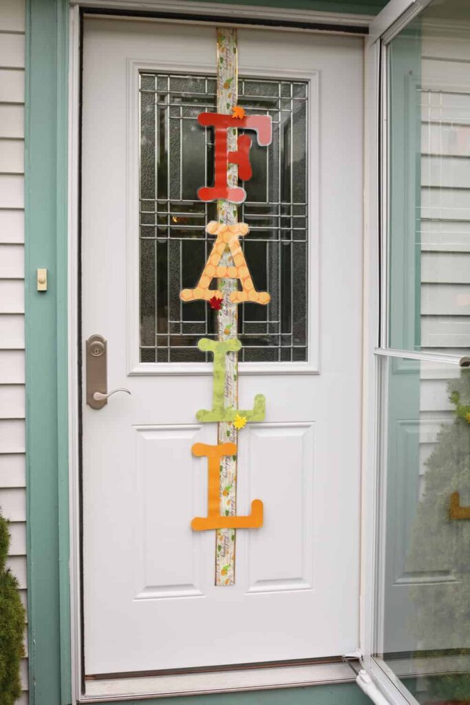 FALL vertically on an outside door attached to ribbon