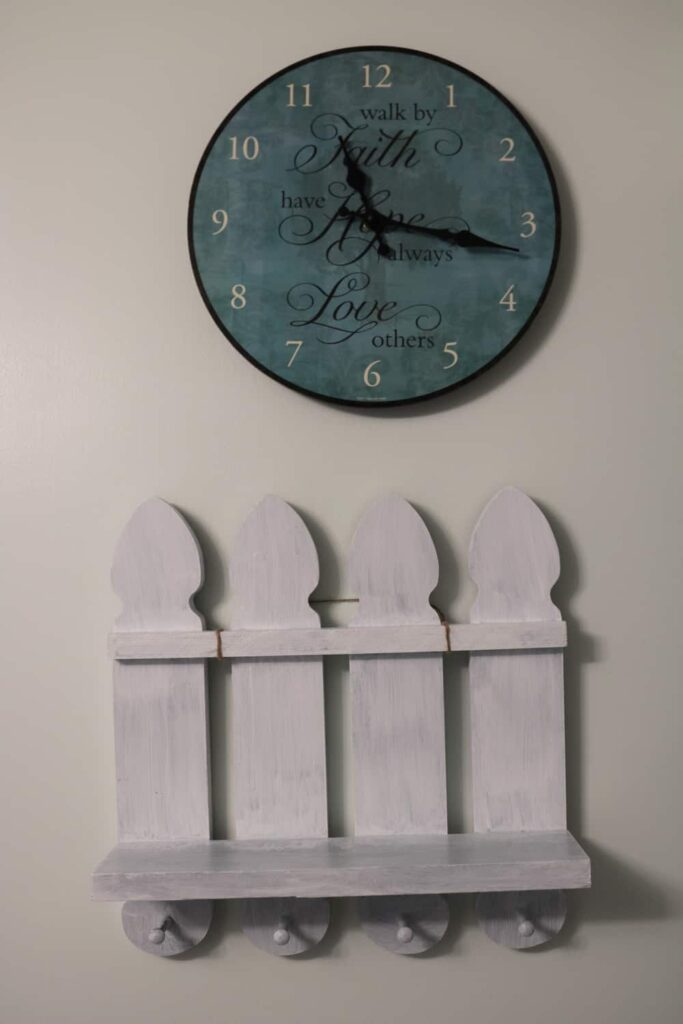 wall shelf with pegs, and clock https://www.b4andafters.com/pet-supply-area