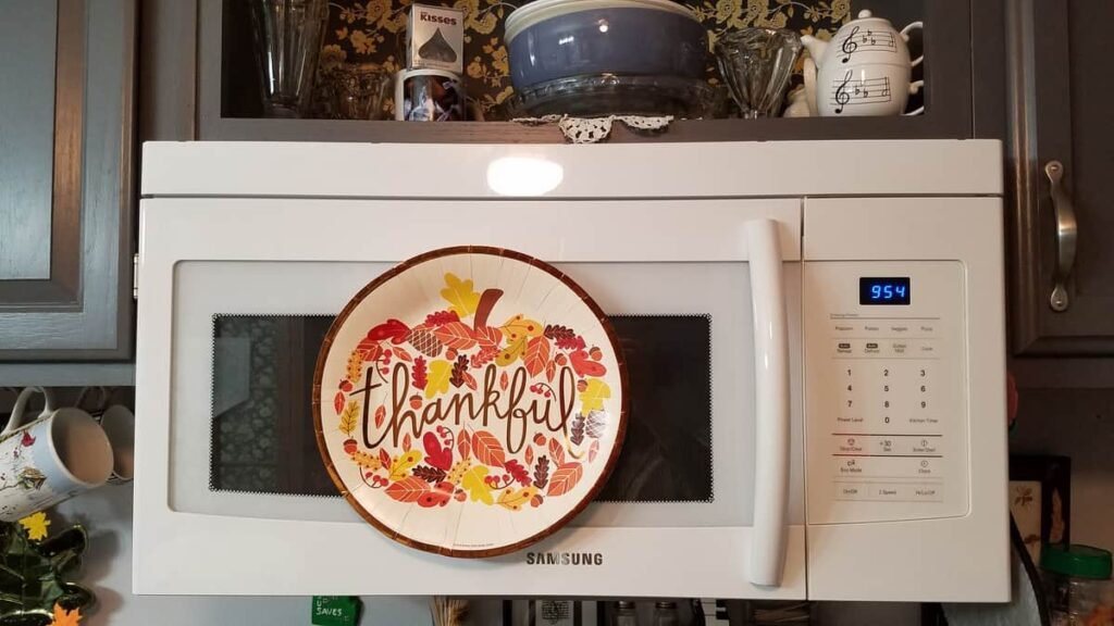 thankful fall paper plate on microwave