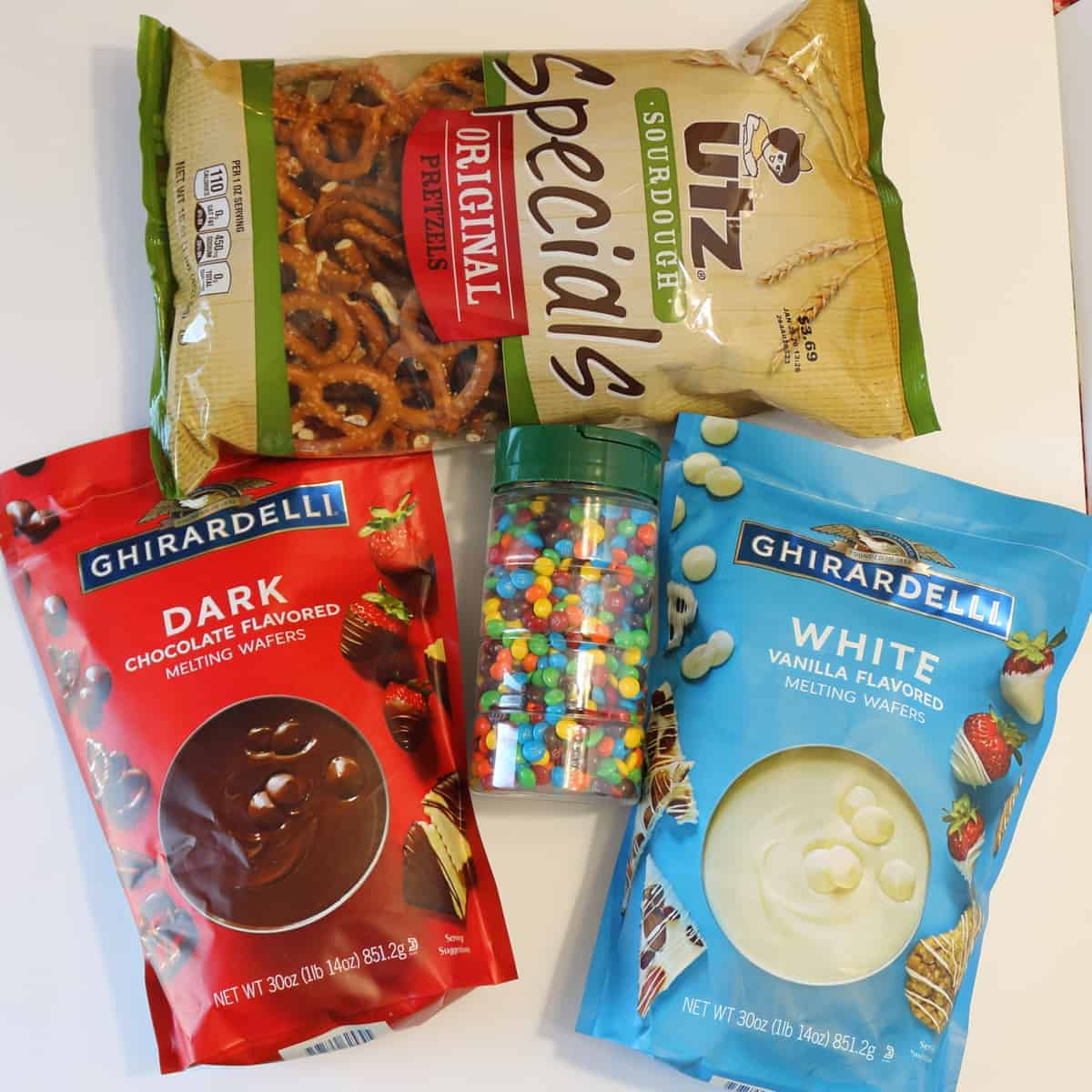 Ghiradelli Dark Chocolate and White Chocolate melting wafers, Utz preztels, and M+Ms
