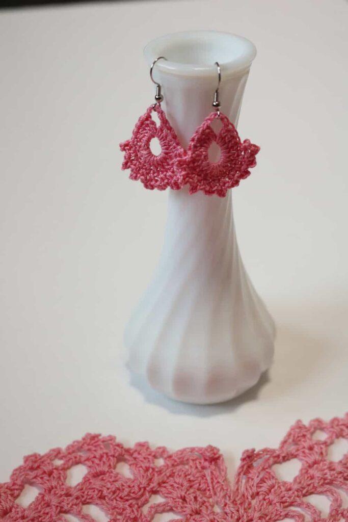 pink earrings hanging from a vase https://www.b4andafters.com/easy-crocheted-earrings/