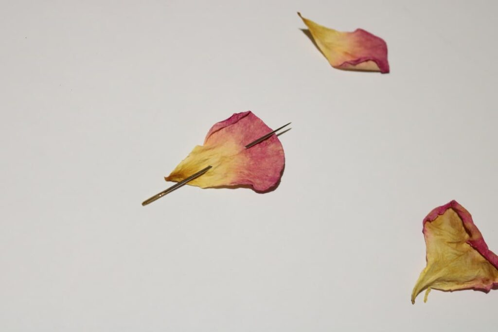 needle with rose petal on it https://www.b4andafters.com/rose-petal-garland