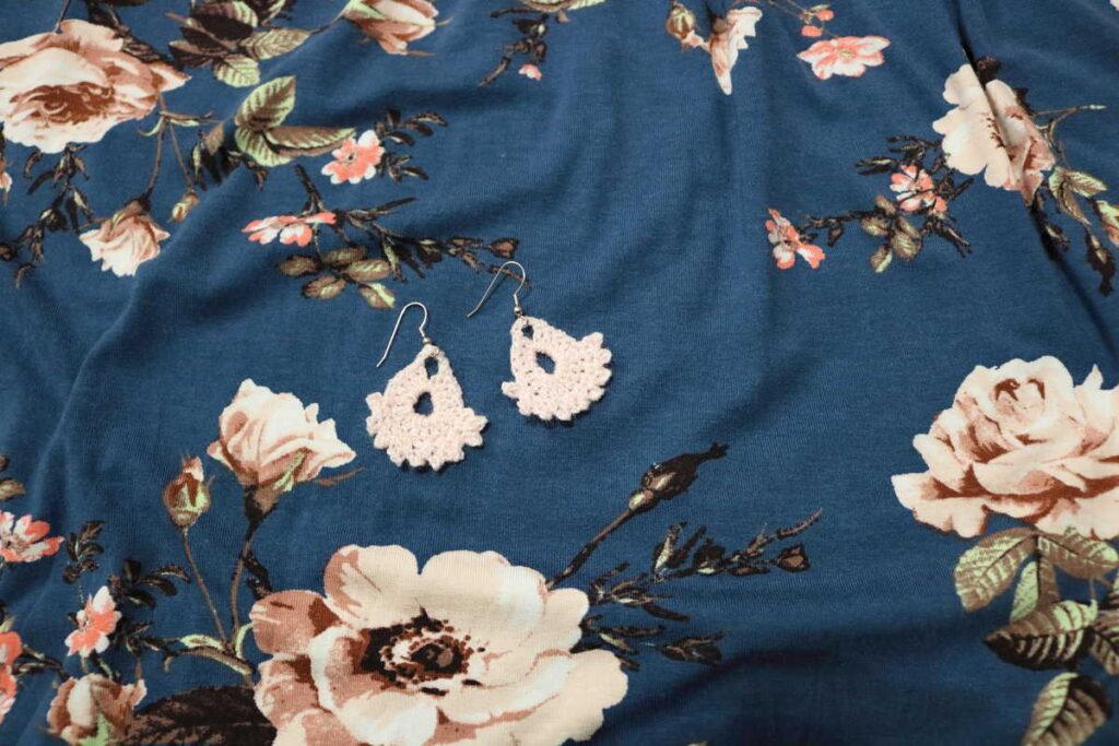 peach earrings on floral background https://www.b4andafters.com/easy-crocheted-earrings/