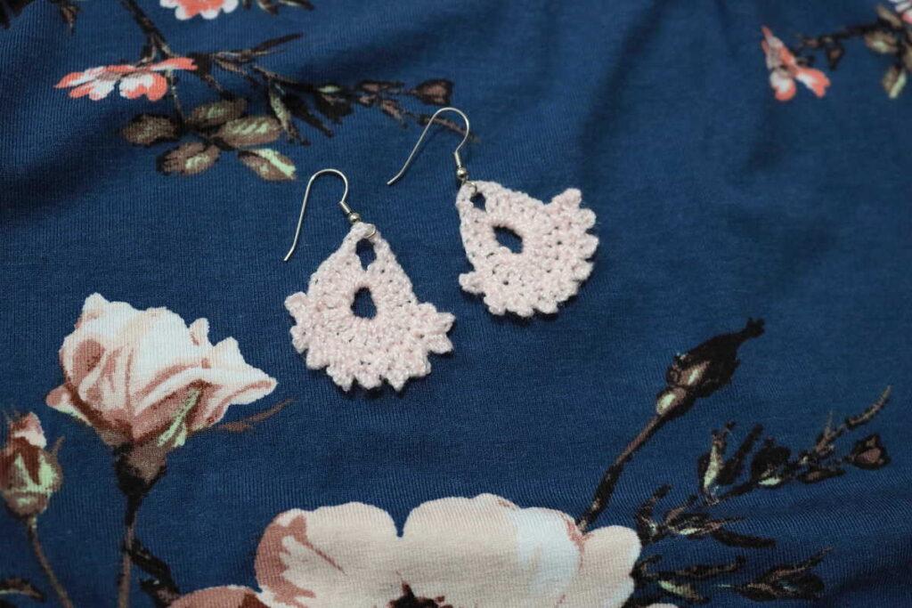 peach earrings on a floral background https://www.b4andafters.com/easy-crocheted-earrings/