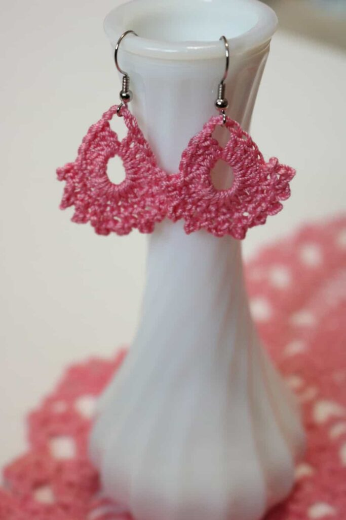 two pink crocheted earrings