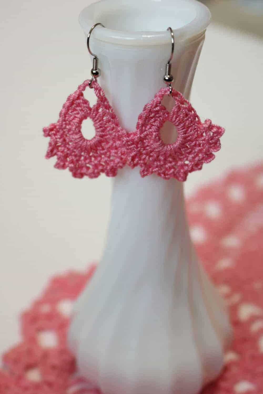 two pink crocheted earrings