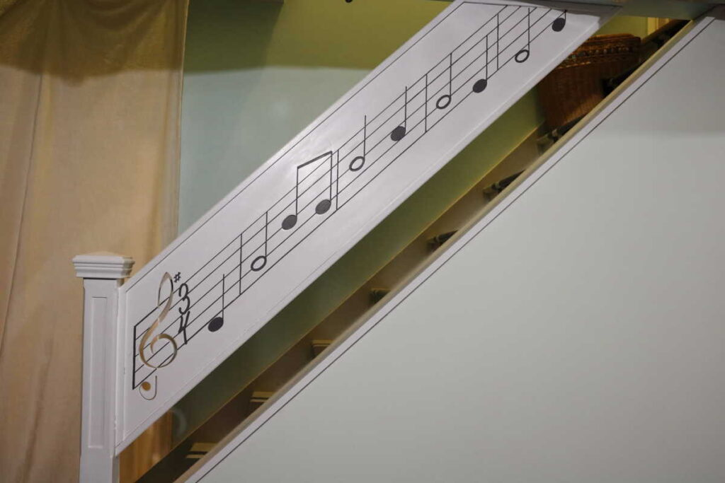 The music railing all painted https://www.b4andafters.com/music-stair-railing