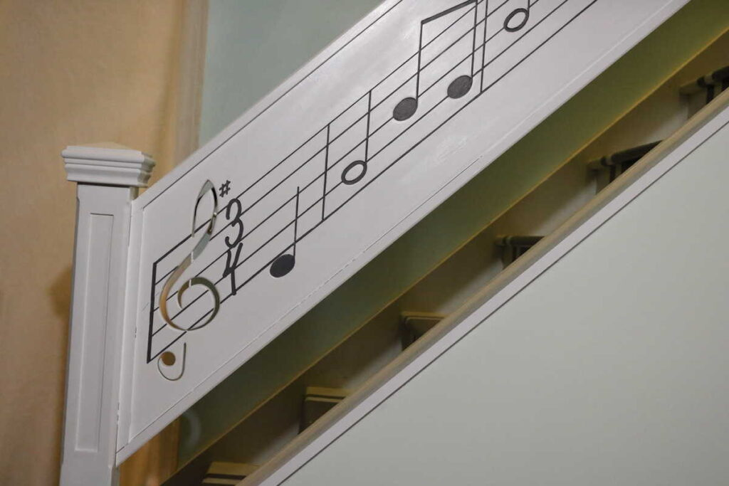 a closeup of the new music railing https://www.b4andafters.com/music-stair-railing