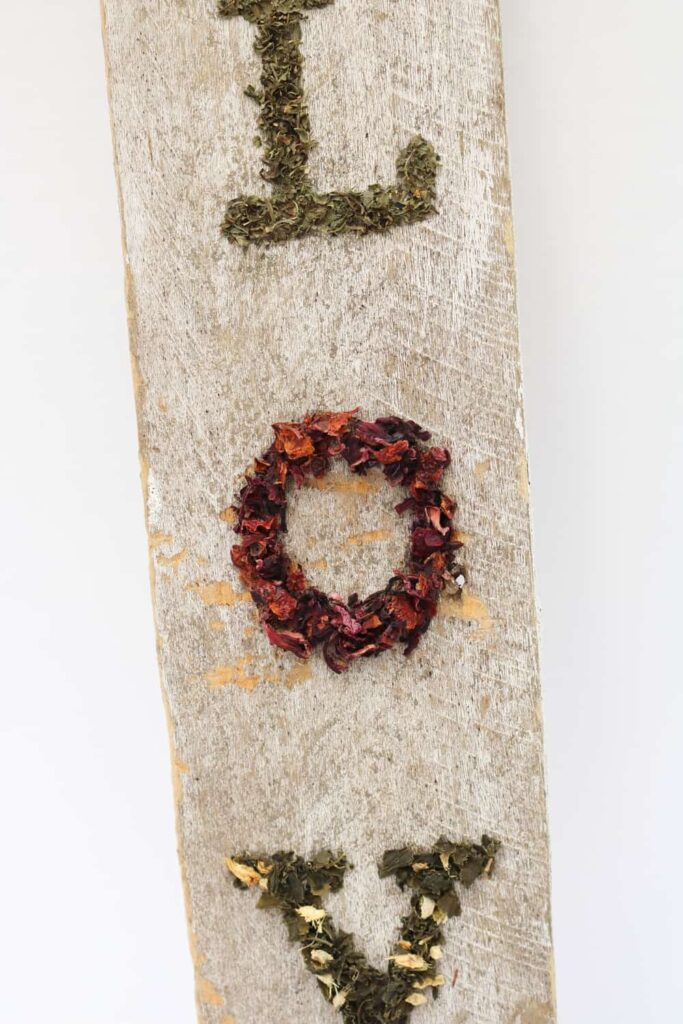 dried tea leaves in the shapes of letters