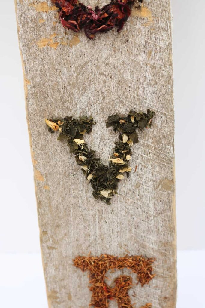 more dried tea leaves in the shapes of letters