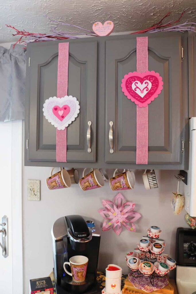 felt filigree hearts on kitchen cupboard doors
