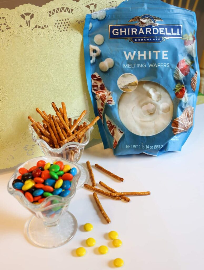 ingredients: white chocolate melting wafers, pretzel sticks, and M+Ms