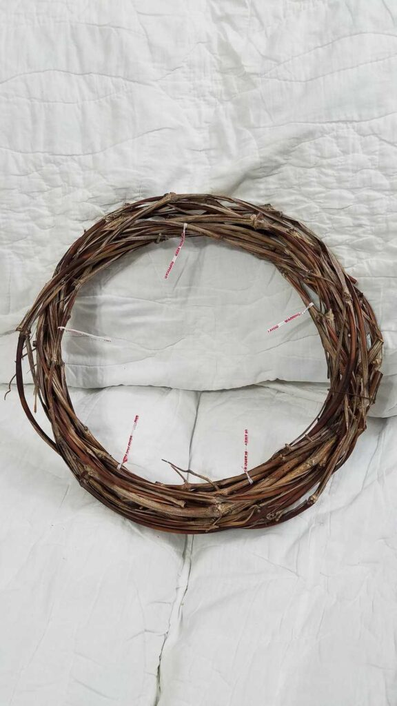 grapevine wreath with twist ties attached