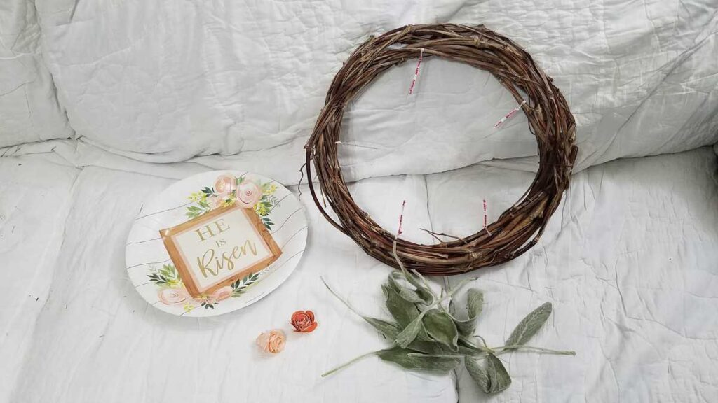grapevine wreath, paper plate, flowers, leaves