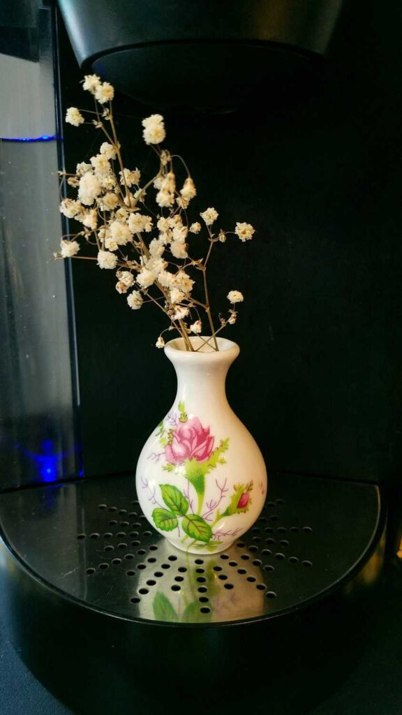 miniature vase with baby's breath flowers
