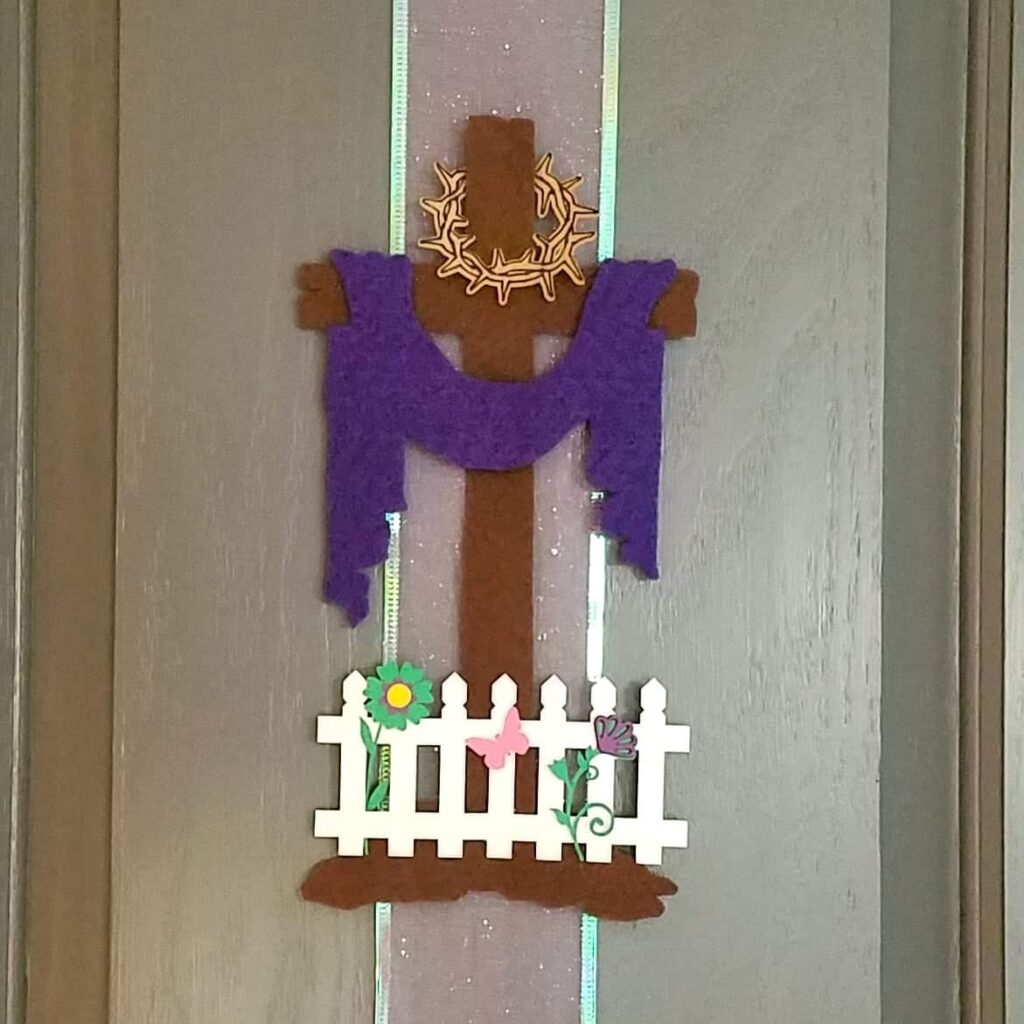 closeup of Easter cross with crown of thorns