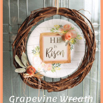 grapevine wreath with He Is Risen paper plate in the center