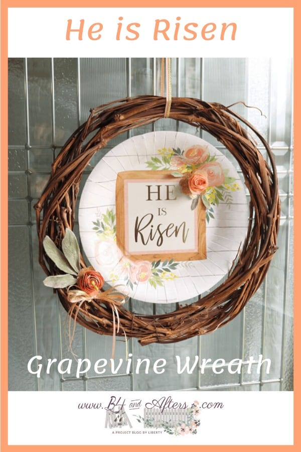 grapevine wreath with He is Risen sign on it for Easter