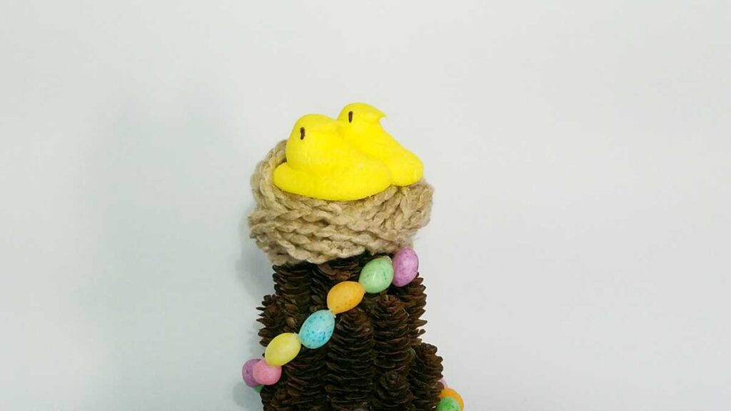 yellow marshmallow chick Peeps on a yarn nest