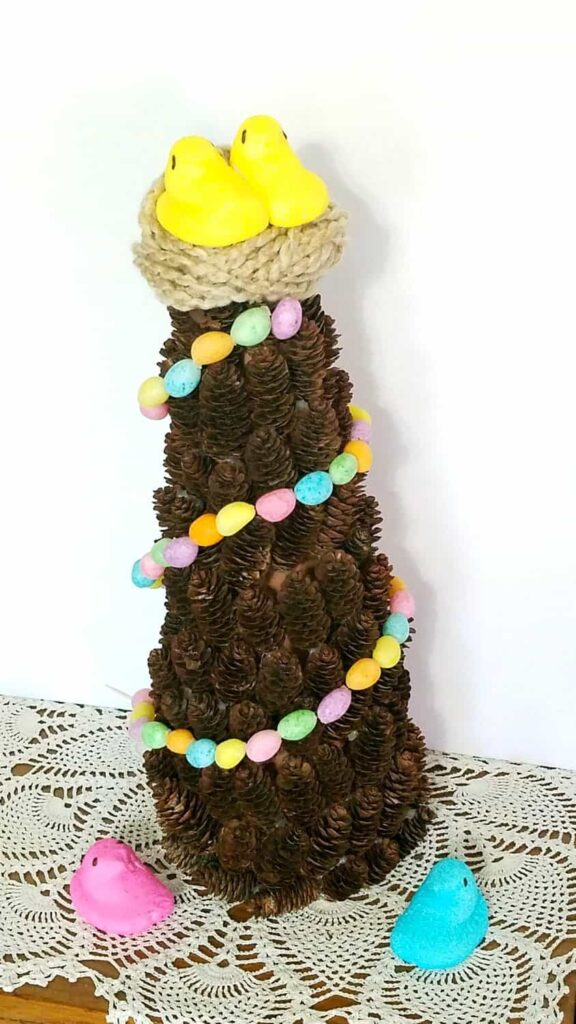 Jelly bean garland on a pine cone tree with yellow Peeps topper