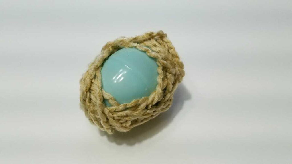 yarn wrapped around a plastic egg