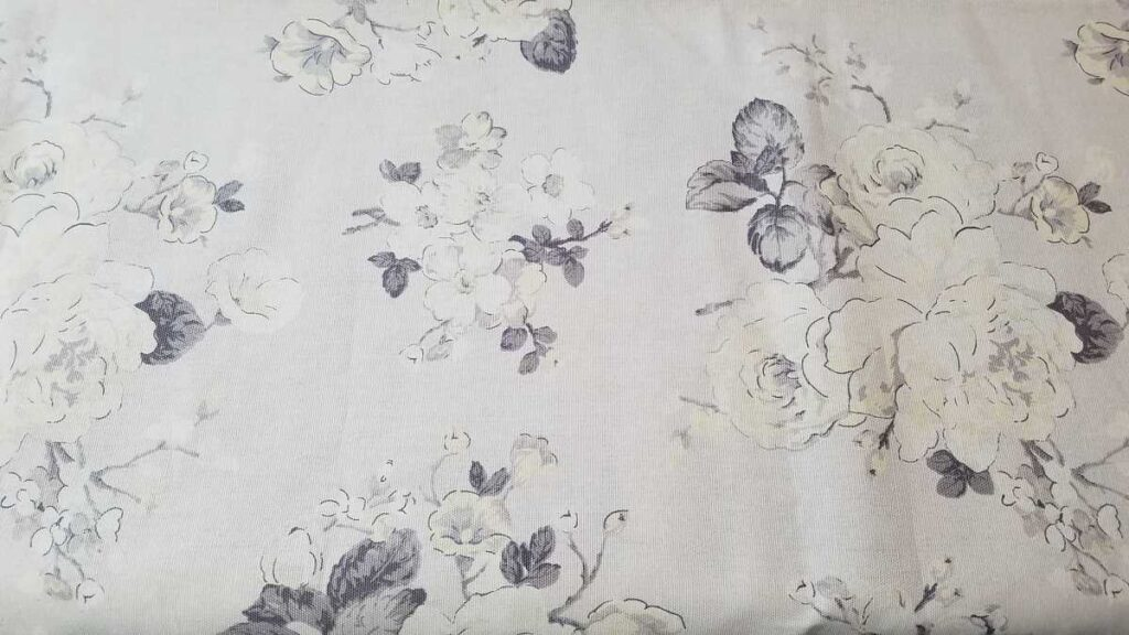 gray and white flower patterned fabric