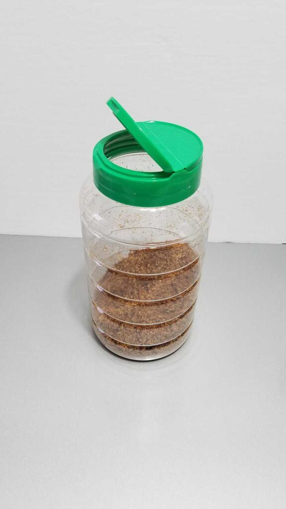 bacon bits in a clear container with a green lid
