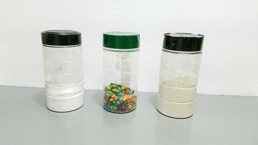 powdered sugar, M+Ms, flour in clear containers