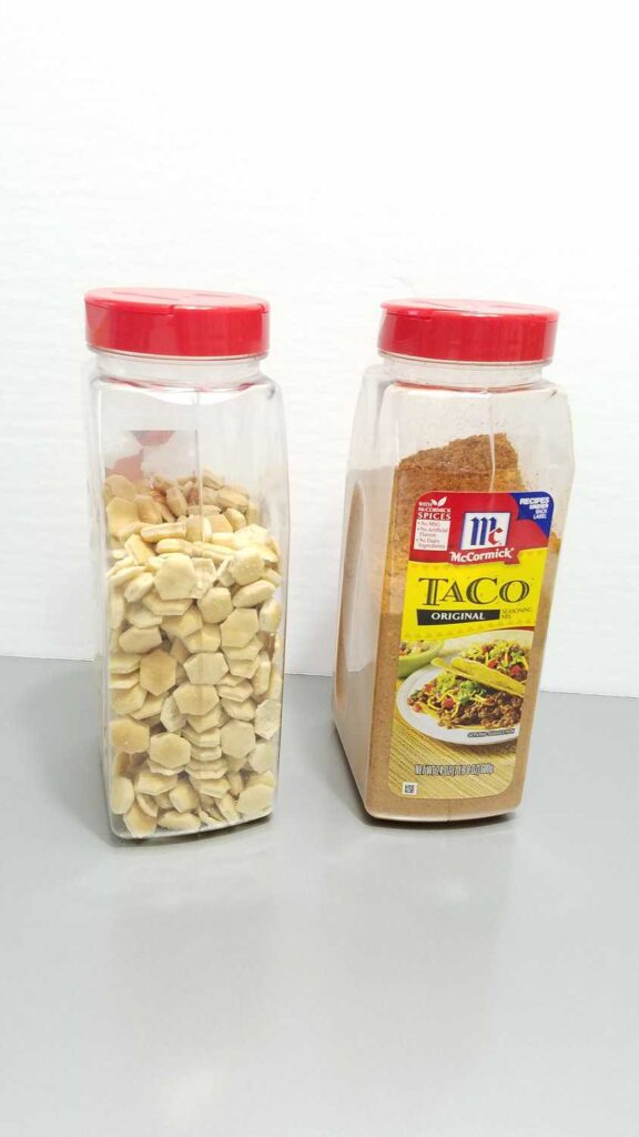 oyster crackers next to a large Taco Seasoning container