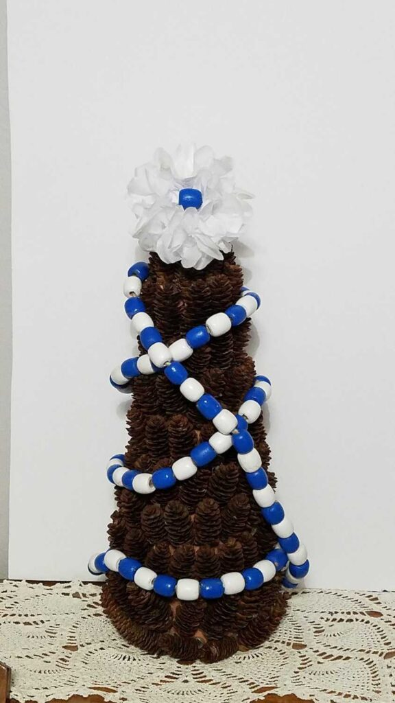 blue and white wood bead garland pine cone tree
