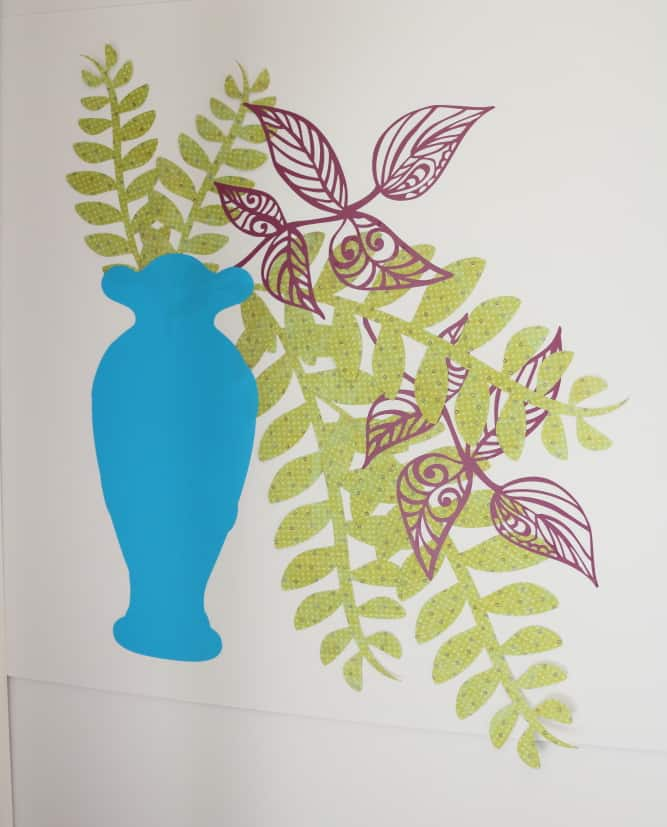 tall blue vase with greenery