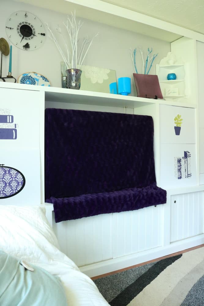 tv decor with purple throw dust cover