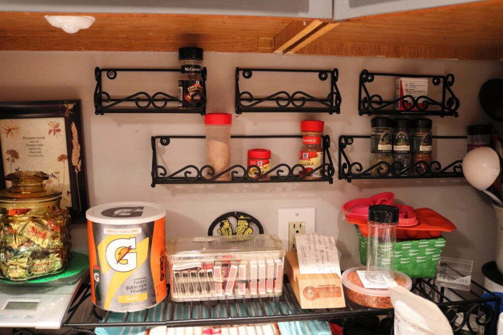 almost empty spice racks on kitchen wall