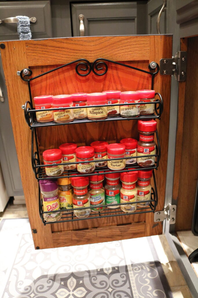 3 shelf spice rack full of spices