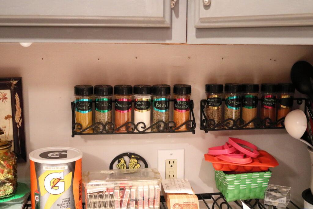 organized spice racks on wall shelf