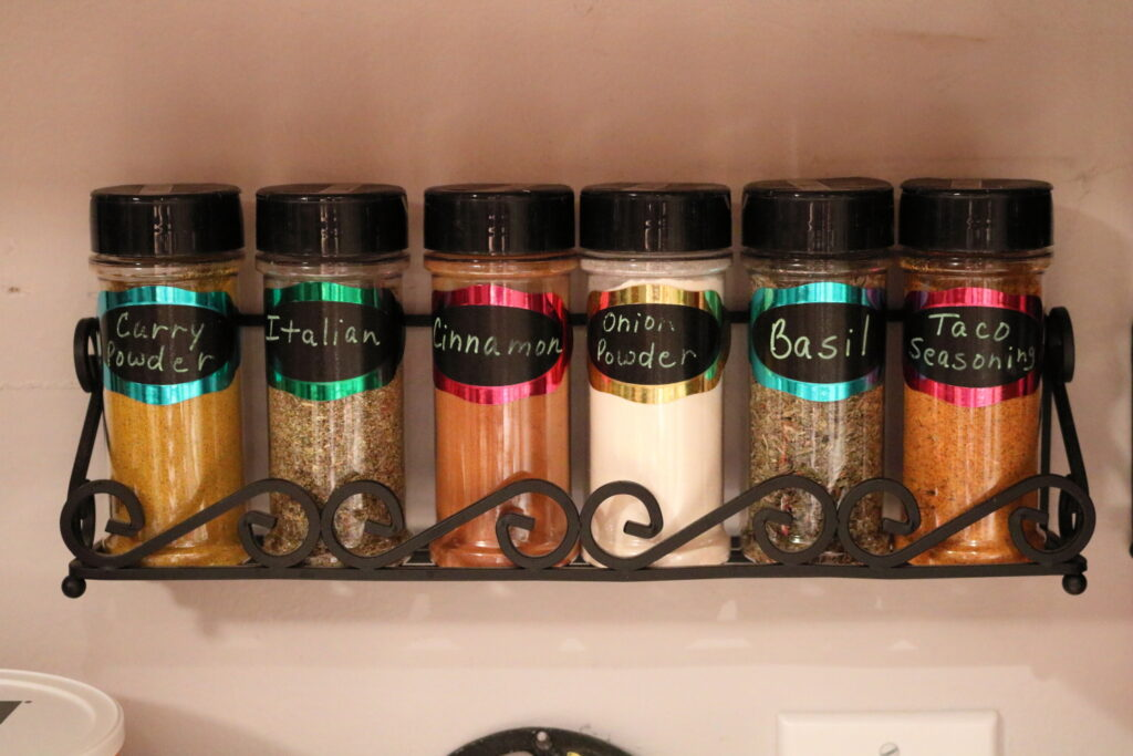 closeup of neatly labeled and organized spices