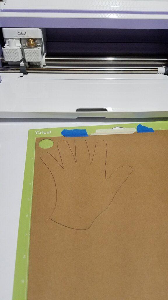 chipboard hand on a cricut mat