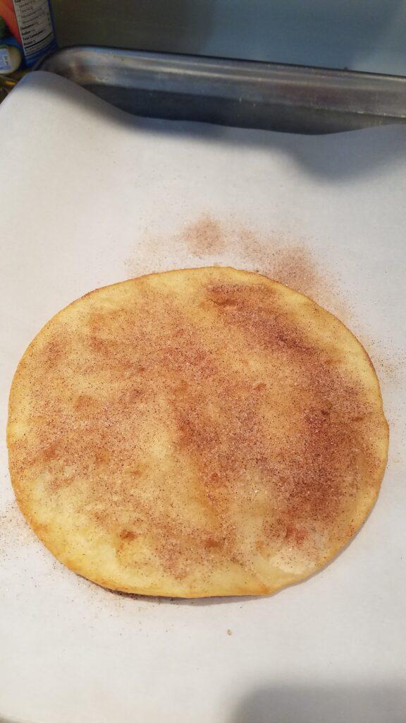 cinnamon sugar on a fried flour tortilla